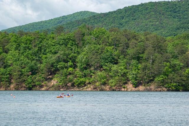 Two kayakers enjoying Carvins Cove Reservoir in Roanoke, VA.
