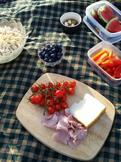 A selection fo picnic foods on a cutting board.
