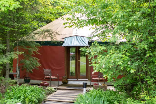 a yurt in the woods in New Haven, Vermont. It is for rent on Glamping Hub.