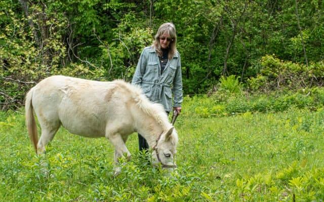 Nahvee, a mini mule with her owner, Ellen.