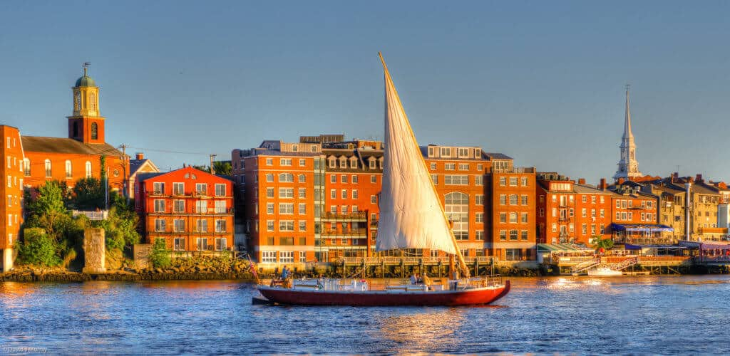 A Gundalow sails down the Piscataqua River in Portsmouth, NH. Photo credit: David J. Murray of ClearEyePhoto.com