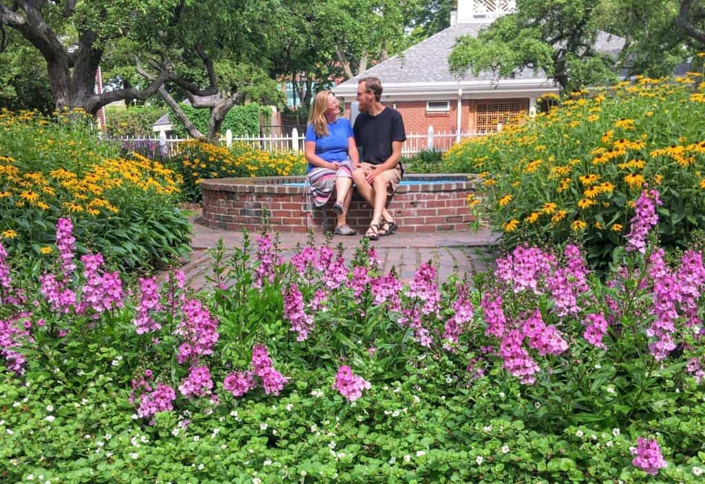 A couple sits near a fountain in Prescott Park in Portsmouth, NH.