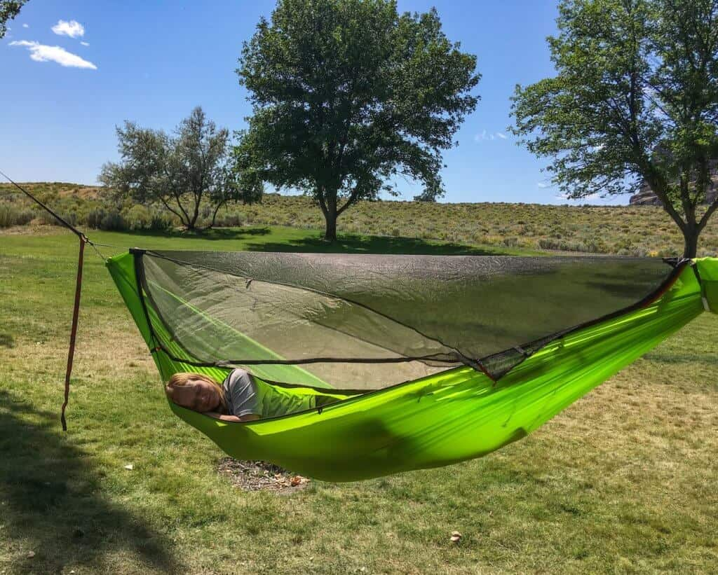 Rosa sleeps in a Kammok Mantis hammock during a camping trip to Washington State.