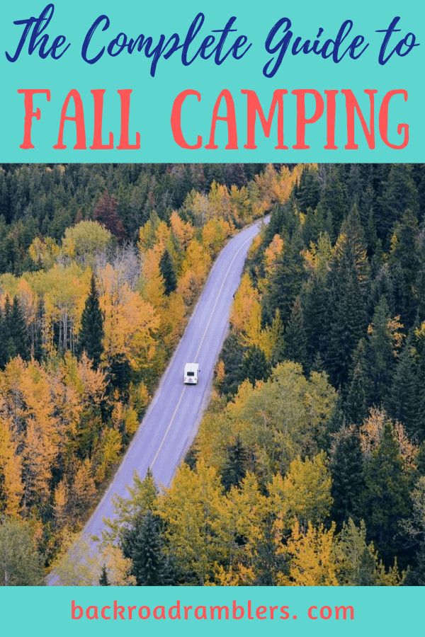 An RV driving through a fall foliage scene. Caption reads: The Complete Guide to Fall Camping.