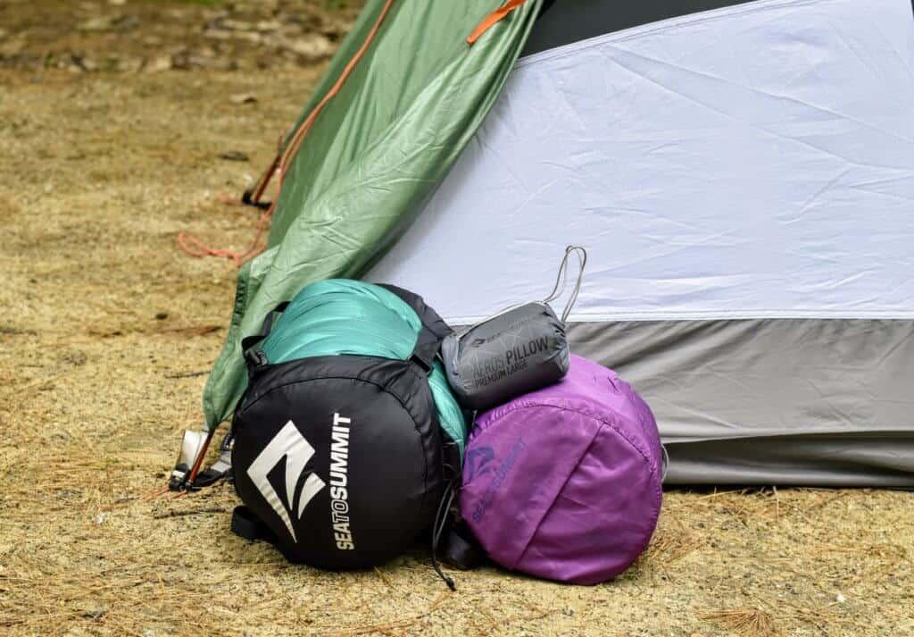 Sea to Summit sleeping bag, pad, and pillow, all in individual stuff sacks.