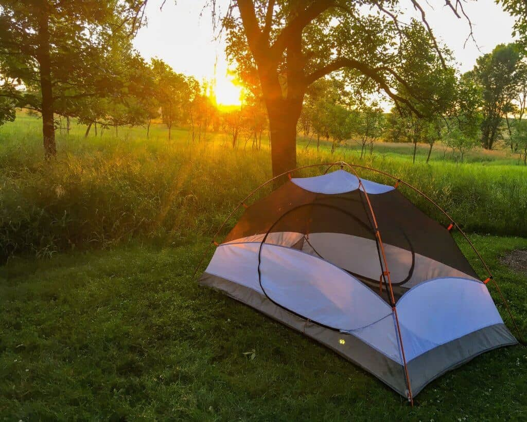 The sun sets over a small tent in Minnesota.