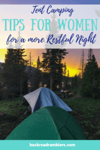 Two tents in the mountains beneath the setting sun. Caption reads: Tent Camping tips for women for a more restful night.