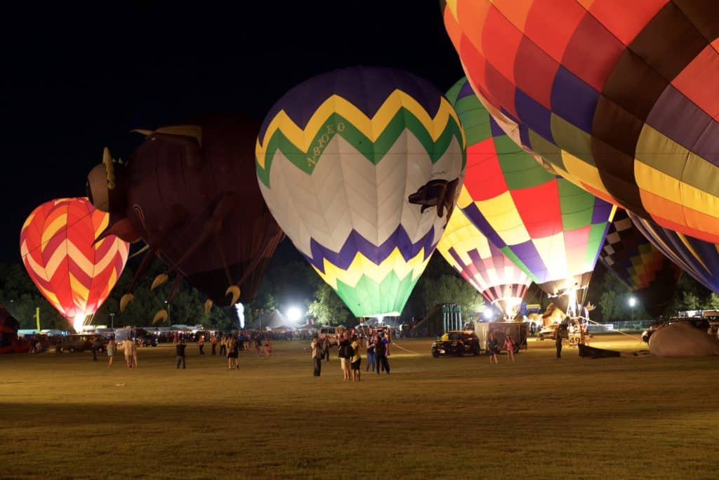 Several hot air balloons on display at the glow during the Plano Balloon Festival in Texas.