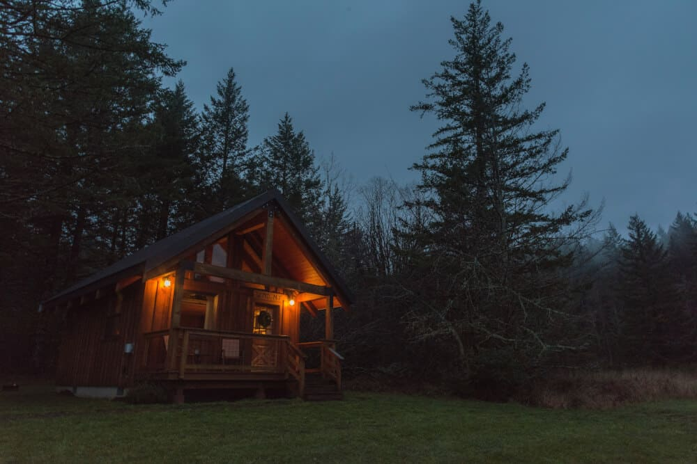 A cabin in the woods at night.