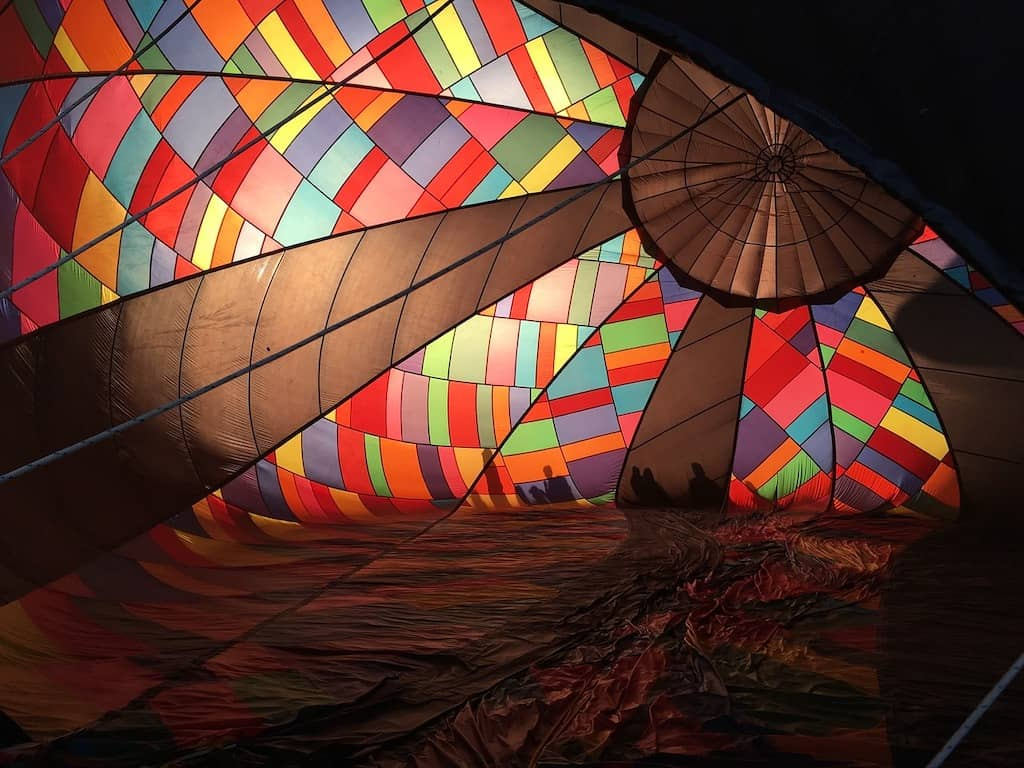 The inside of a balloon during inflation at a hot air balloon festival.