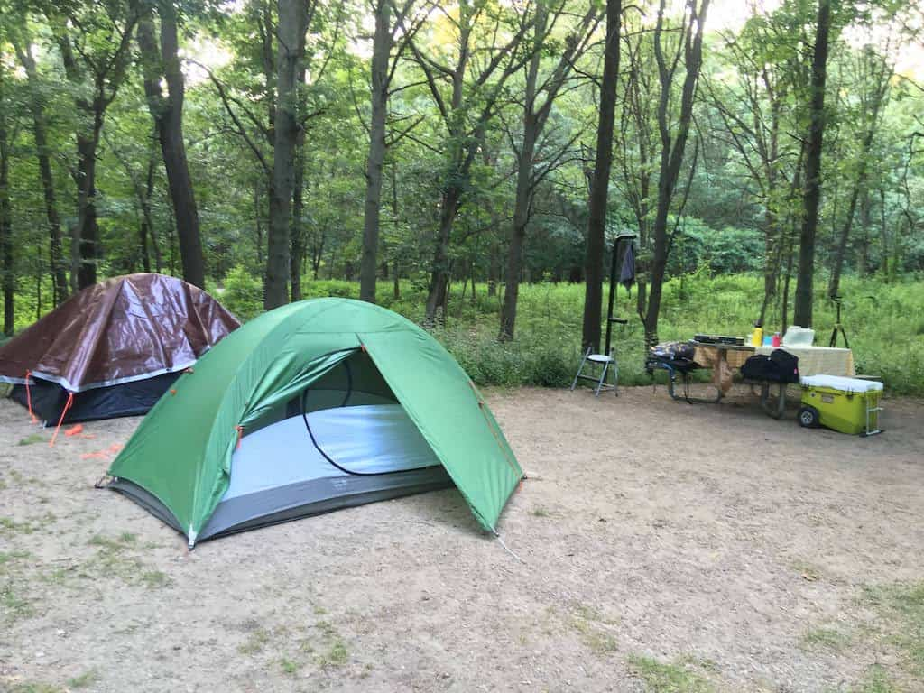 Two tents set up in a campsite at Indiana Dunes National Park.