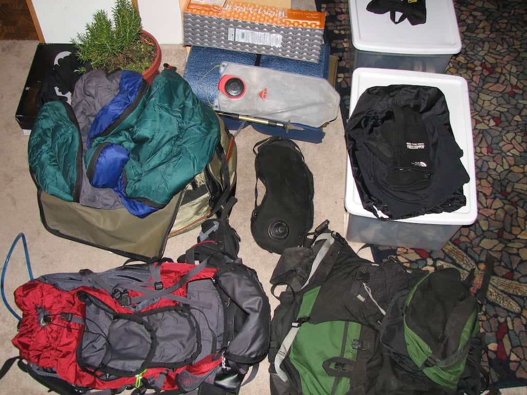 A pile of outdoor gear spread out on the floor. Photo credit: Neil Girling