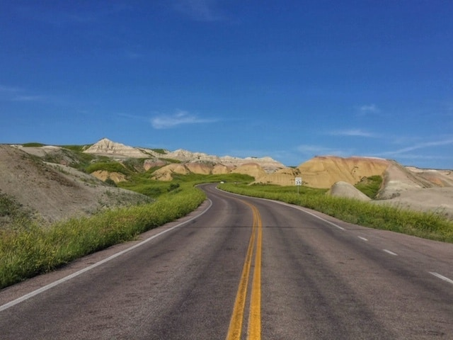 Driving through Badlands National Park in the summer.
