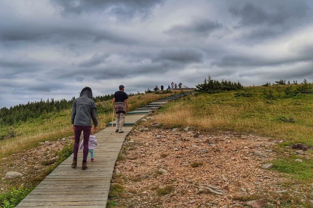 A few people walk on the boardwalk on Cape Breton Island