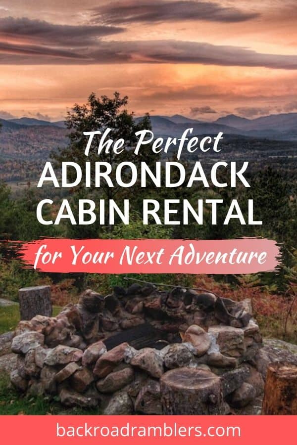A sunset over the Adirondack Mountains. Caption reads: The Perfect Adirondack Cabin Rental in New York.