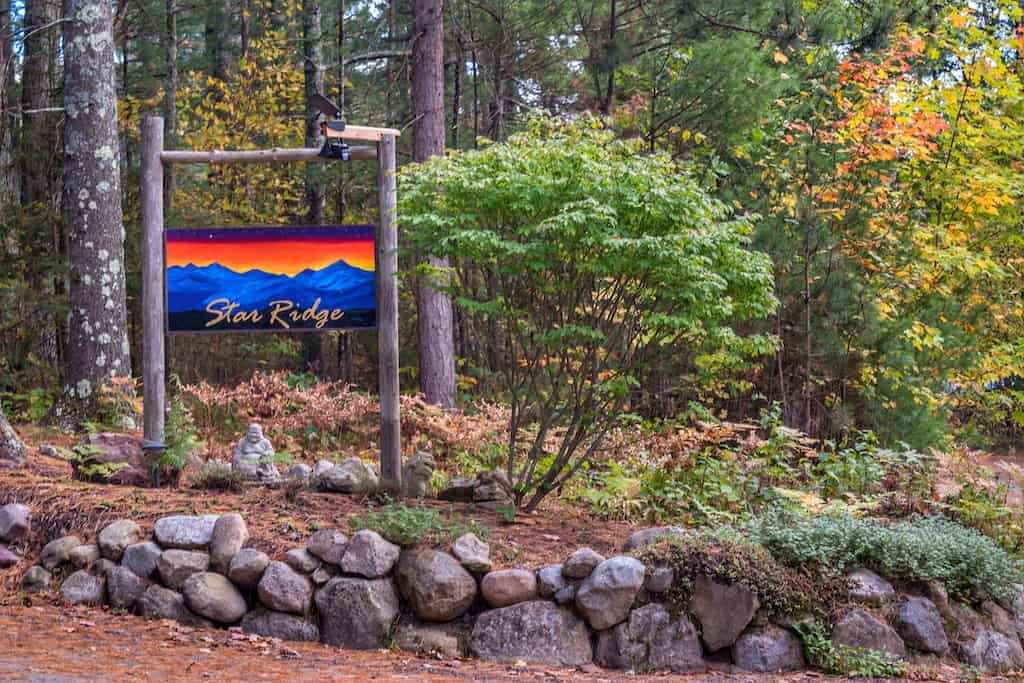 The sign welcoming guests to Adirondack Star Ridge - a collection of Adirondack vacation rentals near Lake Placid.