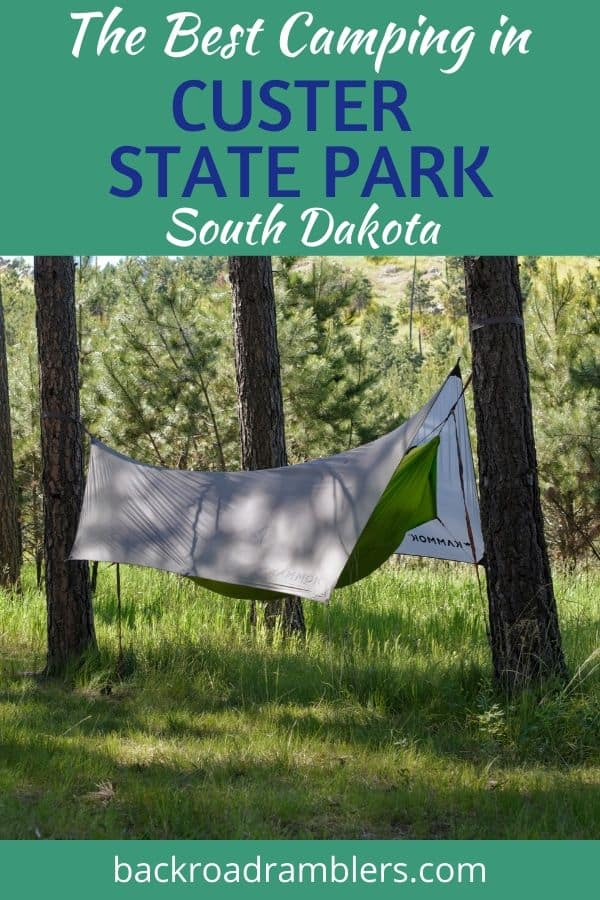 A camping hammock in Blue Bell Campground, Custer State Park. Caption Reads: The Best Camping in Custer State Park, South Dakota.