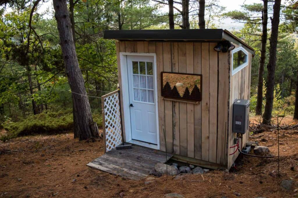 An outdoor shower outside a vacation rental in the Adirondacks of New York.