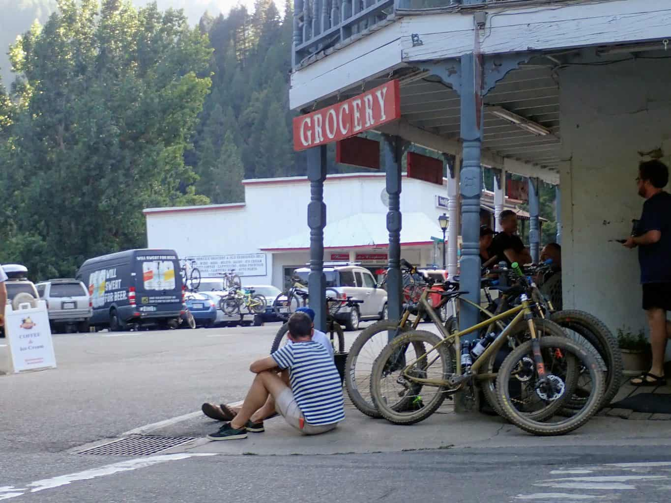 A man sits on the side of the road during the Downieville Classic mountain bike weekend in California