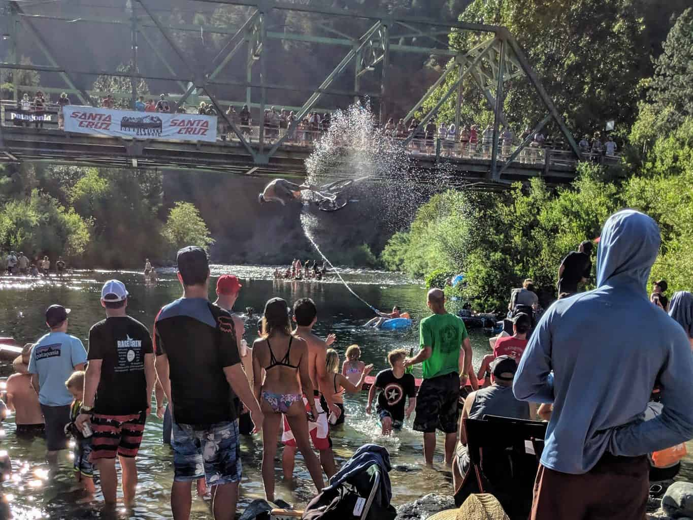 The jump contest over the river at the Downieville Classic Mountain Bike Weekend.