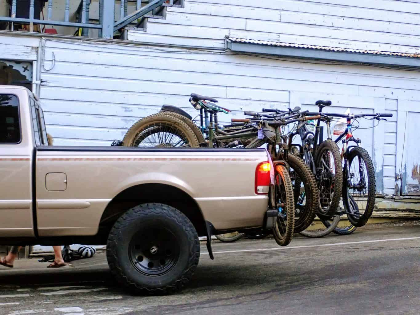 A tan pickup truck holds several mountain bikes during the Downieville Classic Mountain Bike Weekend in California