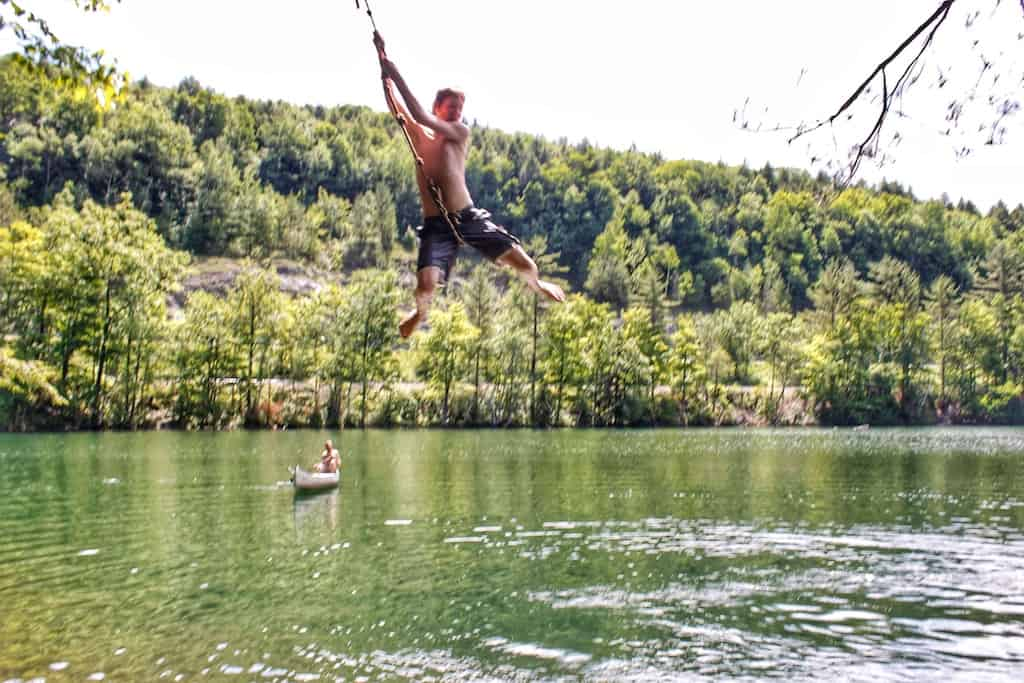 The rope swing at Emerald Lake State Park in Vermont
