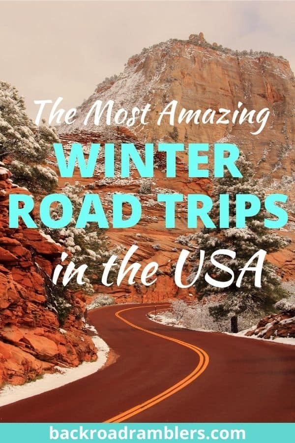 A winding road through the mountains in the winter. Caption reads: Best Winter Road Trips in the USA