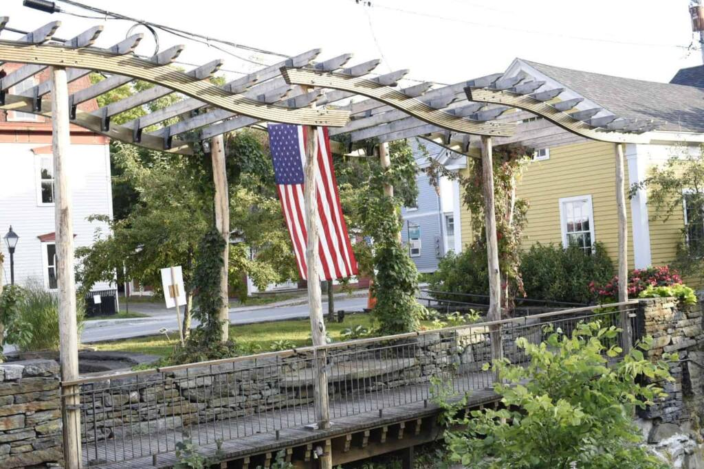 An American flag hanging from a whimsical arbor in Wilmington, VT