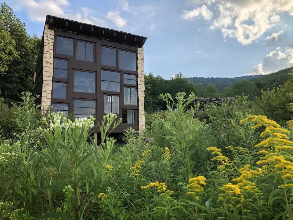 A summer view of the Catskills Birdhouse glamping property in the Catskill Mountains