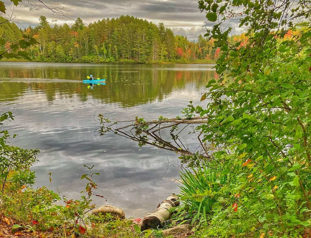 A kayaker on Spectacle Pond in Brighton State Park Vermont