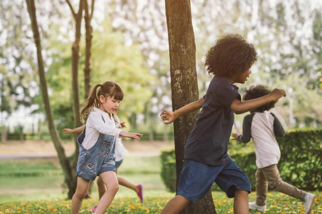 A group of kids running together outdoors