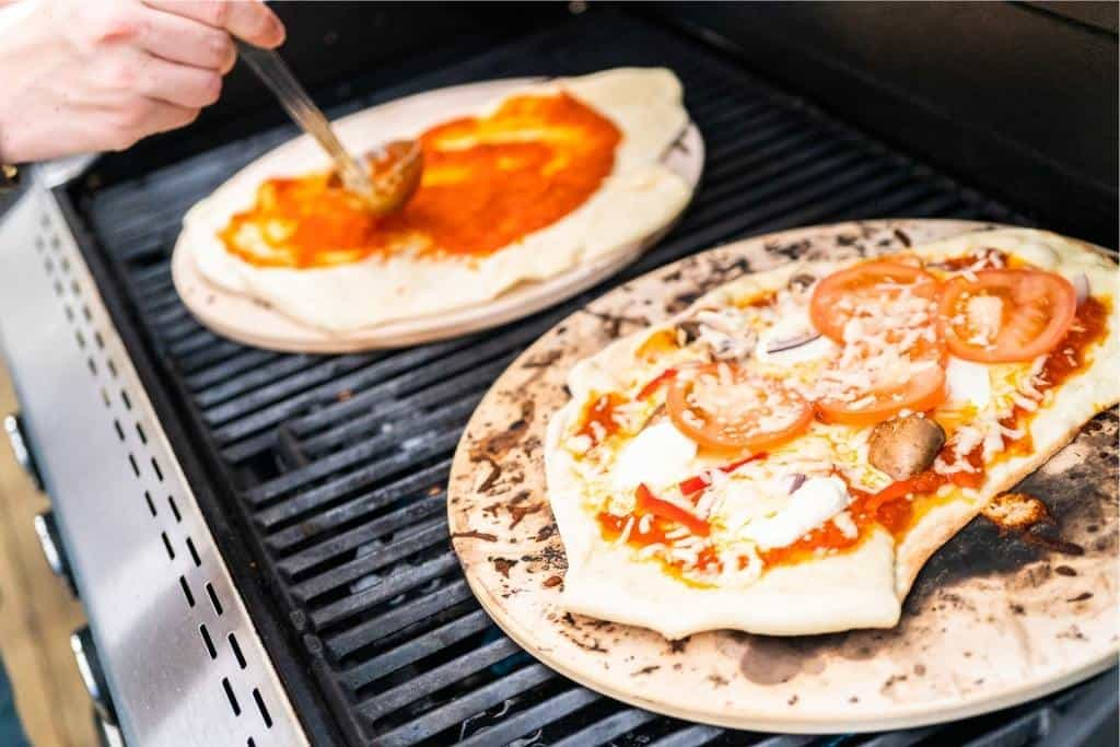 Grilled pizza sitting on a grill