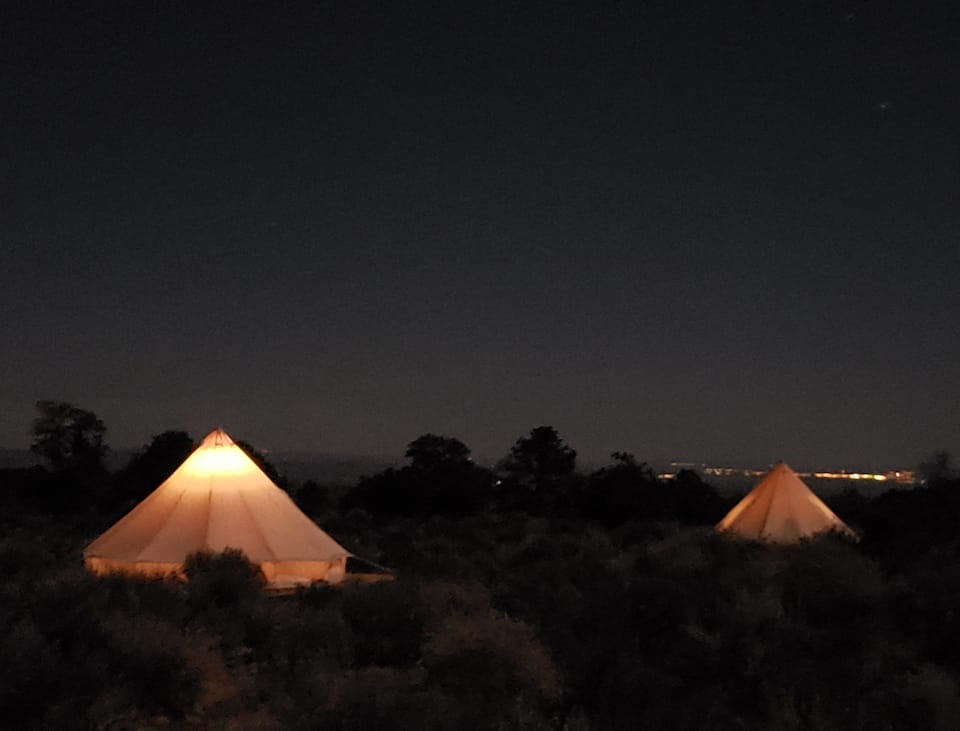 two lit-up glamping tents on the Navajo Nation near the Grand Canyon