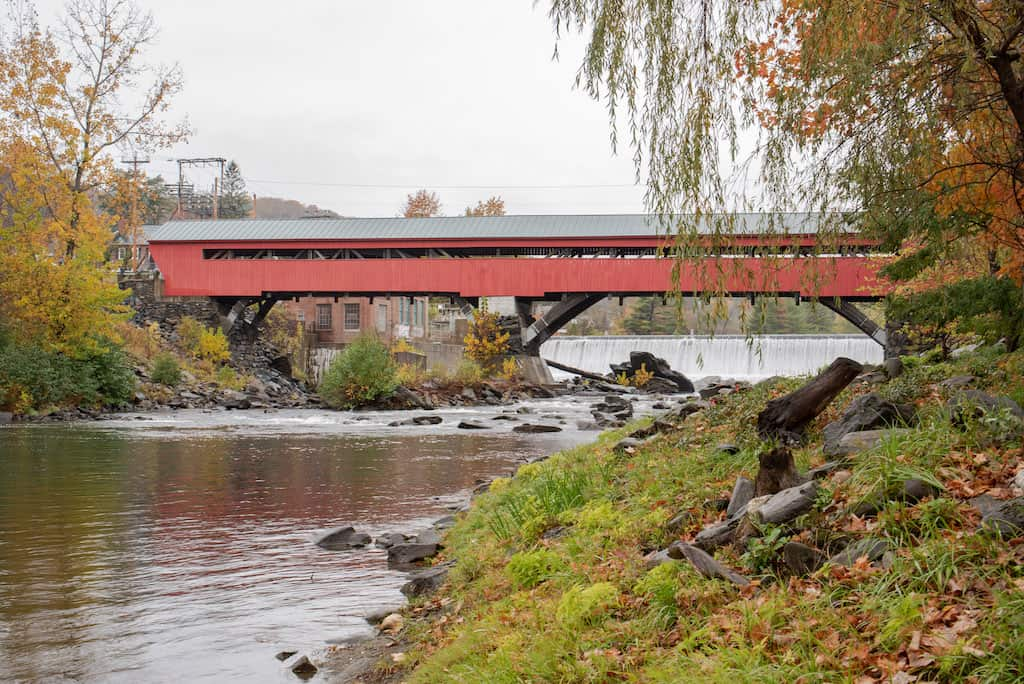 The Taftsville Covered Bridge in Woodstock VT, as seen from the Ottaquechee River below the dam