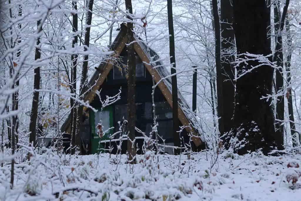 A glamping A-frame covered with snow in Sherburne, New York. Photo credit: Airbnb