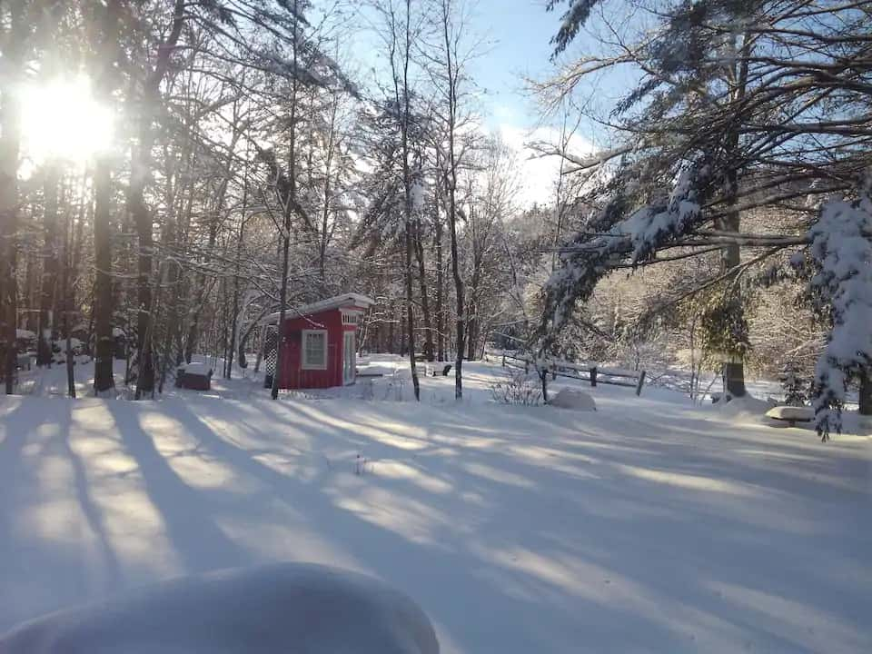 A snowy scene featuring a winter glamping spot in Warren, New Hampshire. Photo credit: Airbnb