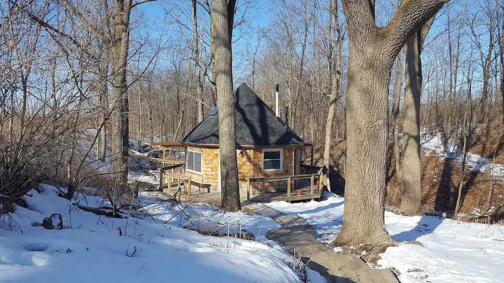 A glamping cabin in Ovid, NY covered with snow. Photo credit: Airbnb
