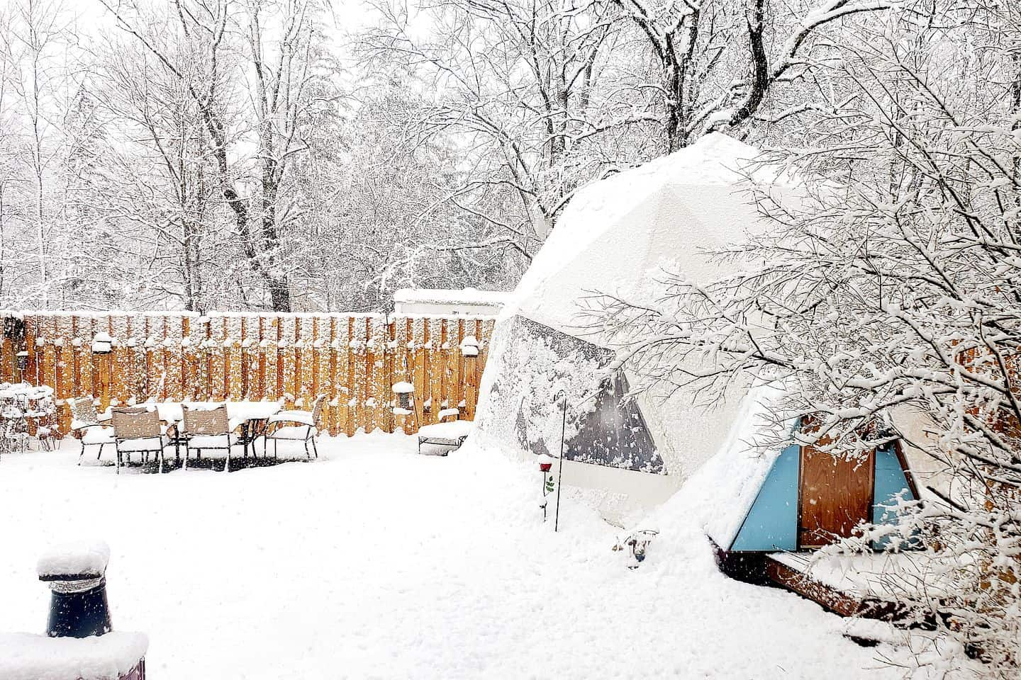 A glamping dome covered with snow in Hensonville, New York. Photo credit: Glamping Hub