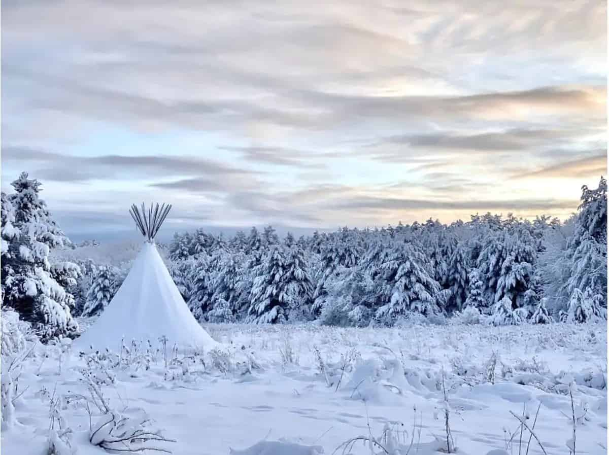 A tipi covered with snow in Accord, NY. Photo credit: Airbnb