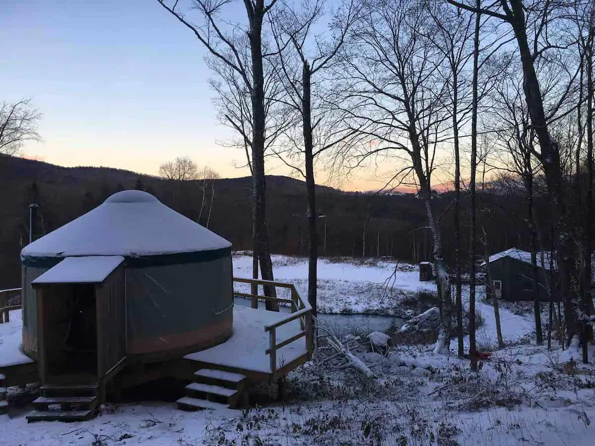A yurt covered with snow. Available for rent on Airbnb.