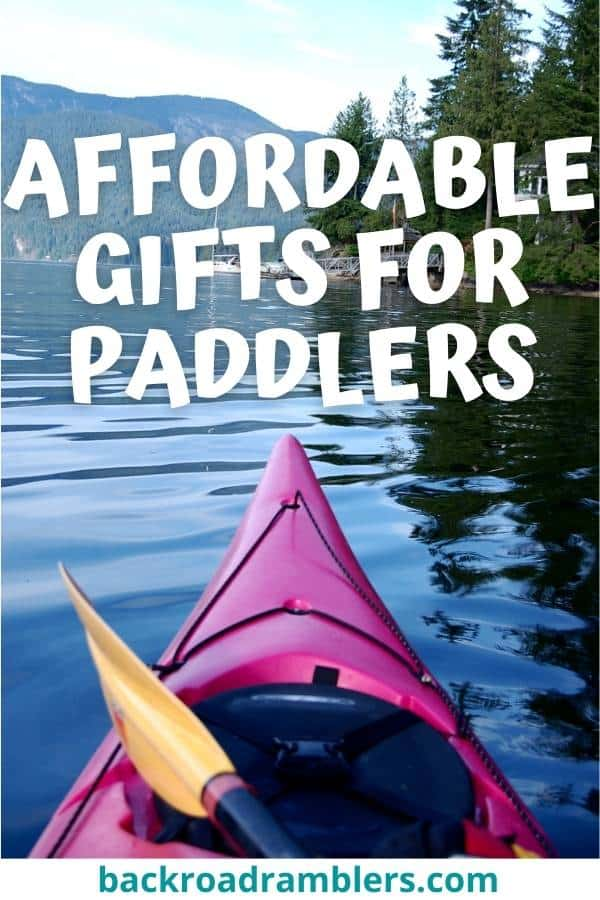 The front of a kayak looking toward a mountain lake. Caption reads: Affordable gifts for paddlers