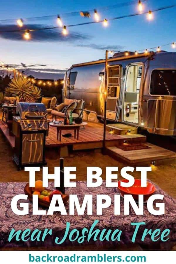 A night view of an Airstream glamping rental near Joshua Tree. Caption reads: The Best Glamping Near Joshua Tree