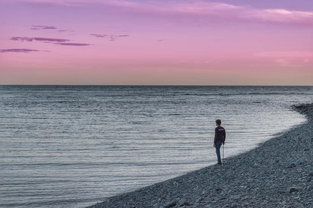 Gabe watching the sunset over the Bay of Fundy in New Brunswick, Canada