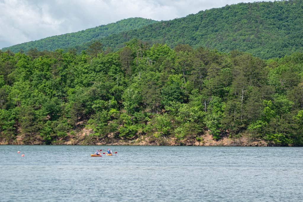 Two kayakers paddling on Carvins Cove in Roanoke Virginia.