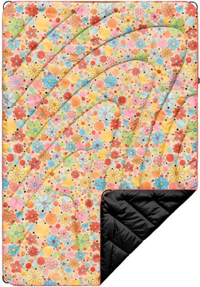 A colorful puffy blanket made by Rumple featuring bright flowers.