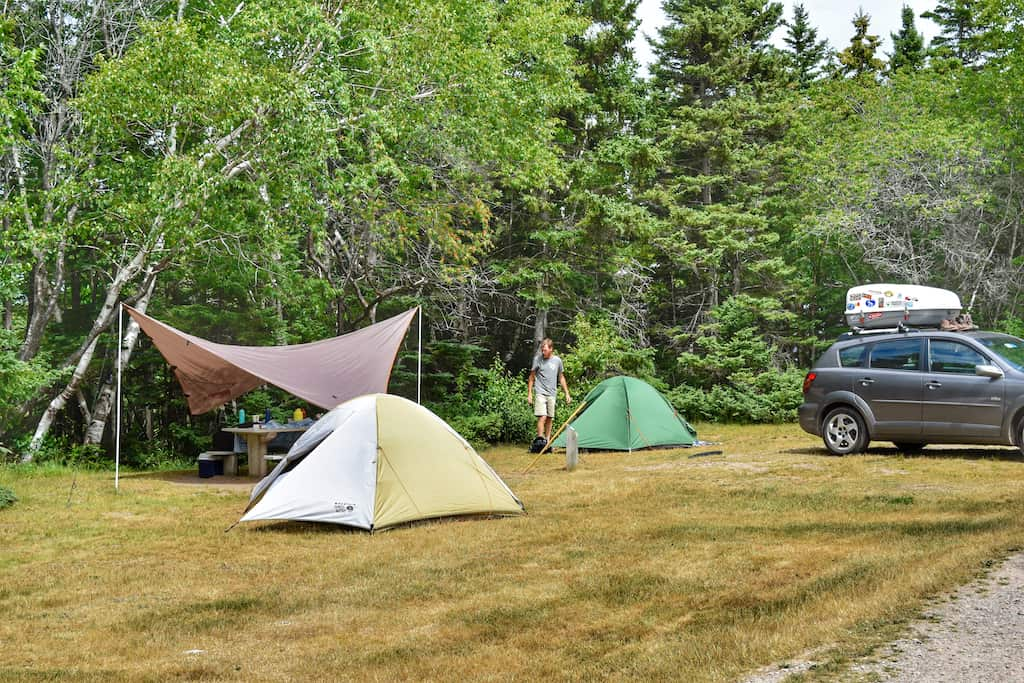 Two tents set up in Broad Cove Campground in Cape Breton Highlands National Park in Nova Scotia.