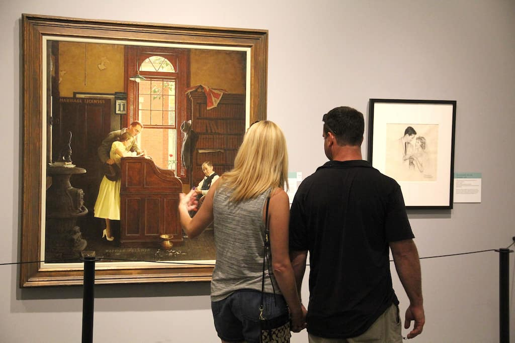 A couple looking at a painting in the Norman Rockwell Museum in Stockbridge, MA.