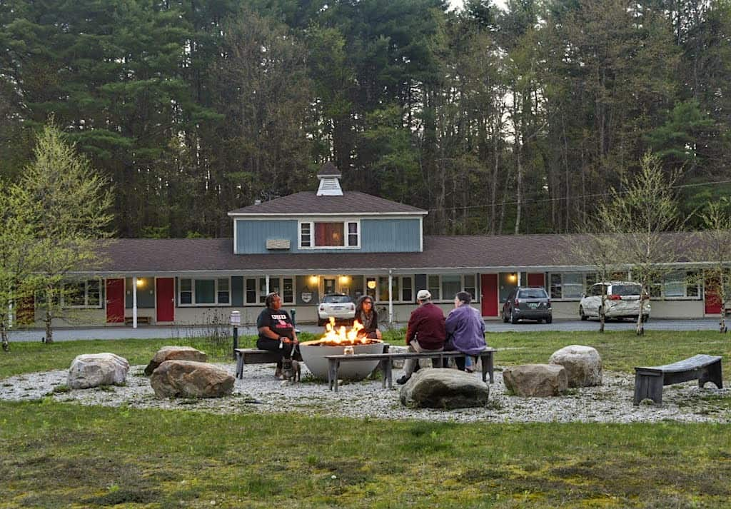 Visitors relaxing around the fire pit at the Briarcliff Motel in Great Barrington, Massachusetts.
