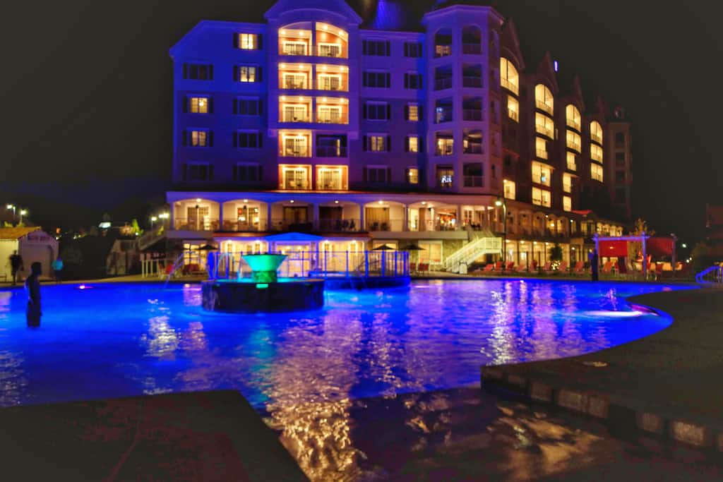 A night view of the pool at RiverWalk Resort at Loon Mountain in New Hampshire.