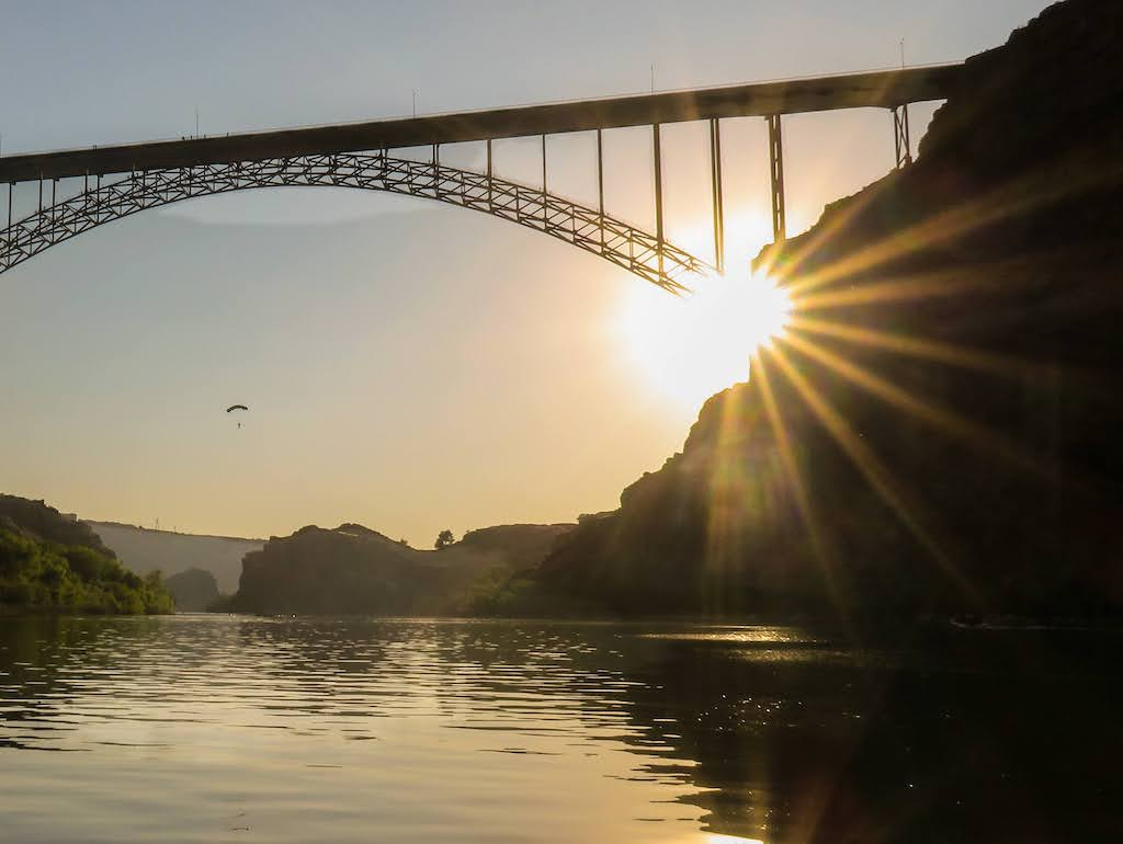 A sunset view of the Perrine Bridge in Twin Falls, Idaho. There is a BASE jumper in the distance.
